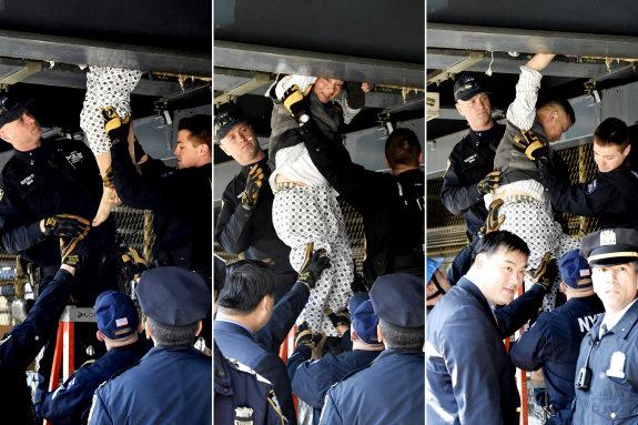 米NY、マンハッタン橋の隙間に住み着いた中国人、警察から排除4