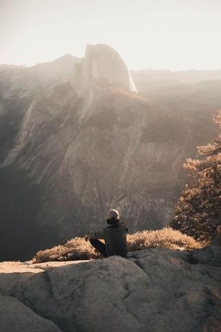 hiker on top mountain