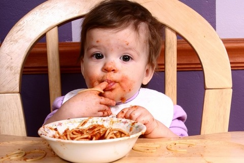 messy-baby-eating-spaghetti