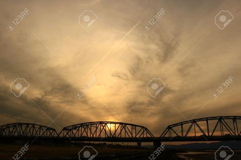 78390786-truss-bridge-and-the-setting-sun-Stock-Photo