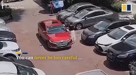 Cautious driver measures width of her car before parking