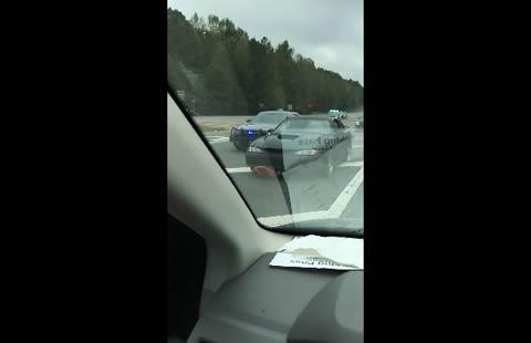 Police Flip Suspect's Car in Chase
