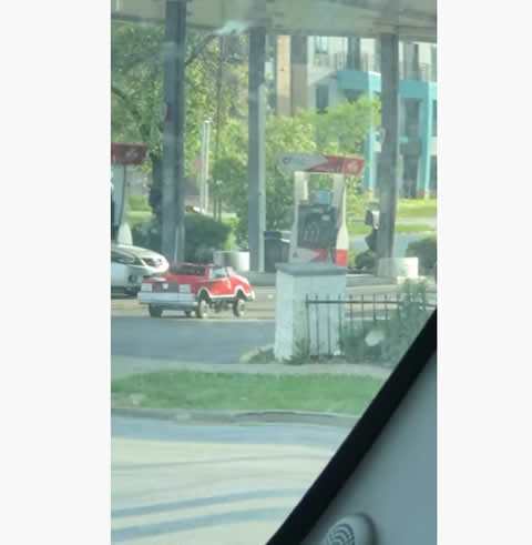 Dude Cruises Off in Tiny Car