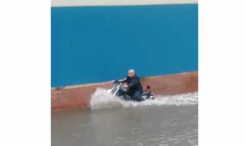Motorcycle Vs. Flood