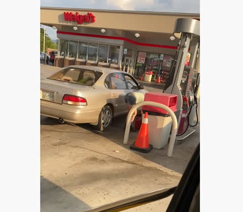 Woman Has Inefficient Way to Get Gas