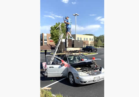 Parking Lot Musician Performs on Top of Car