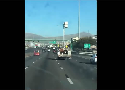Truck Drives With Boom and Basket Up