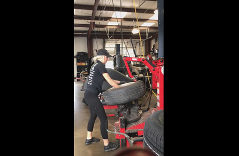 Girl Performing a Reverse Mount at the Shop