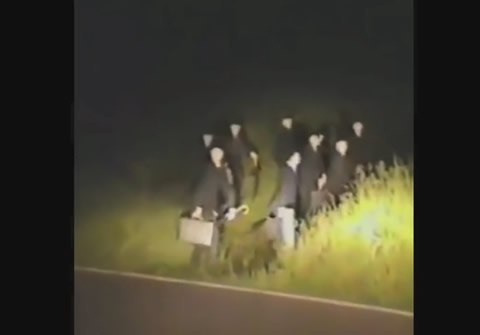 GROUP OF MEN WEARING SUITS RUNNING FROM CAR