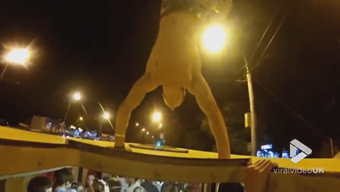 Guy exits bus through the roof