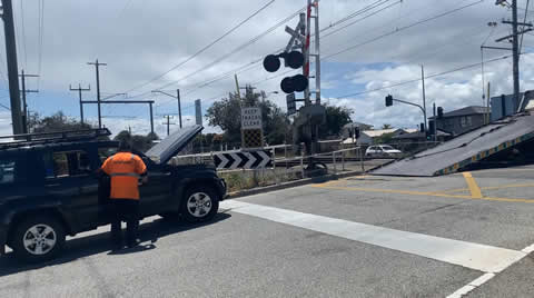 Tow Truck Picks Up SUV From Train Tracks