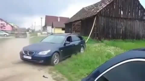 BMW wagon failed demolishing house