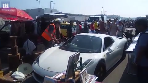 Hilarious moment Ferrari driver gets stuck in Brighton market