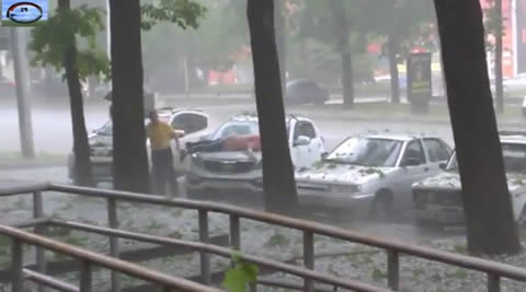 Lady Desperately Tries To Protect Her Car From Hail