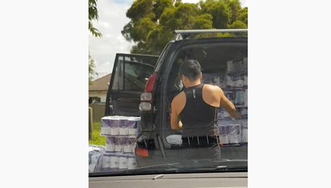 Couple Loads Pallets of Toilet Paper into Van