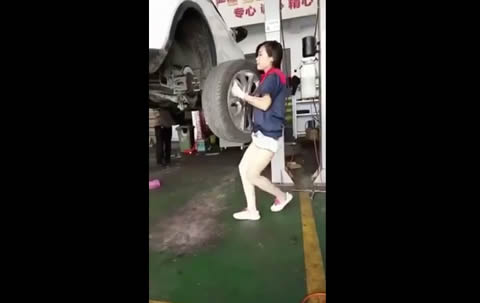 Chinese girl working at a tire shop