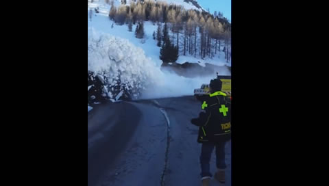 Avalanche Down Hill Cascades onto Road