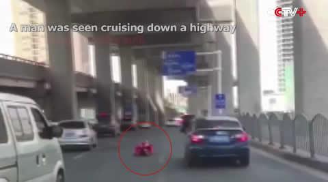 Police Detain Man Speeding Down Highway in Roller Suit