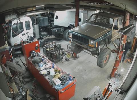 Jeep Falls off Lift in Shop