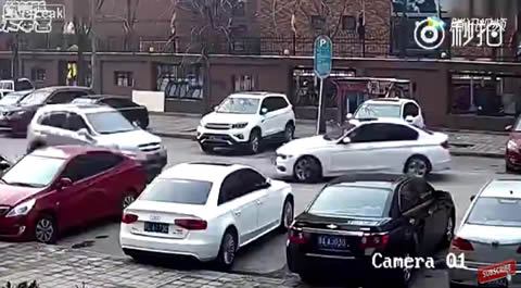 White BMW hits black Chevy out of parking space