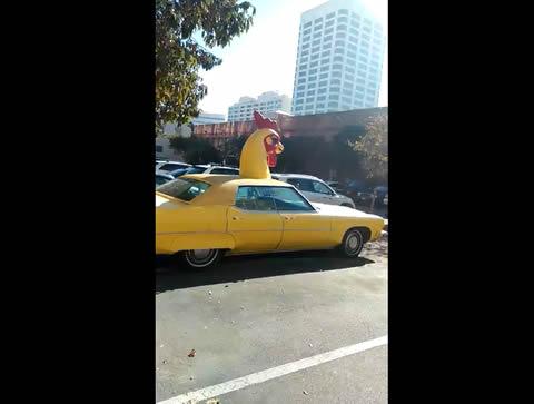 Wierd chicken low rider car on the street