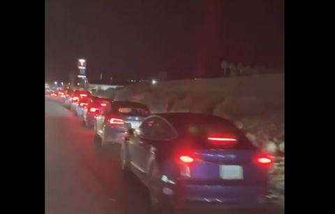 Long Line of Electric Cars Wait for a Charge