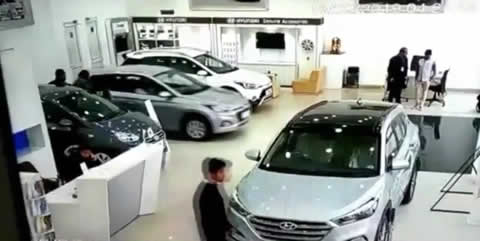 Lady Driver crashes through glass at a dealership