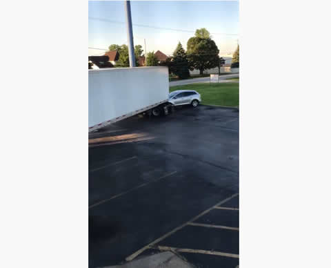 Semi Truck Driver Wrecks Motel, Cars, and Drives Off