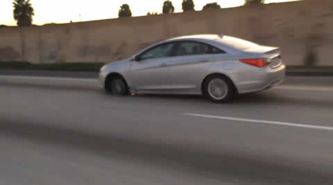 Speeding Car Is Missing A Tire