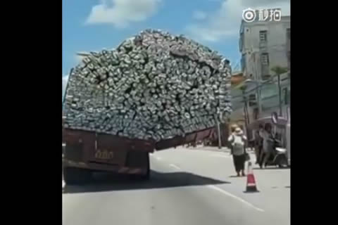 Truck with unbalanced load runs on road