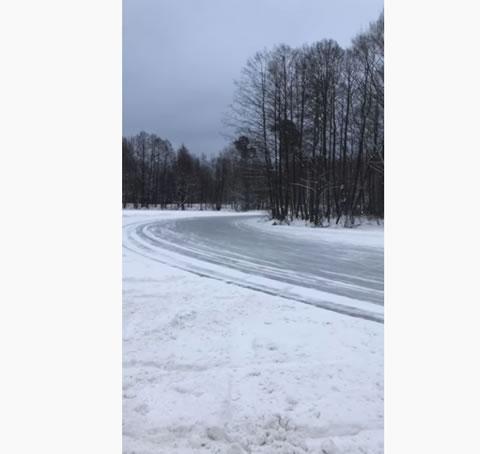 Group of Cars Slide Around Icy Corner
