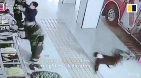 Chinese firefighters slip on floor