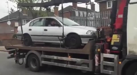 Idiot Tries to Drive His Car off Tow Truck
