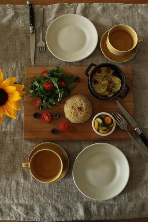 Oven-RoastedPotato Quinoa MesclumGreens CherryTomato BlackOlive Pickles GingerTea