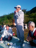Y澤会長のハーモニカ演奏