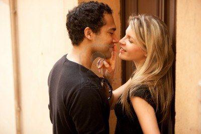 7651439-a-couple-flirting-in-an-outdoor-european-urban-setting