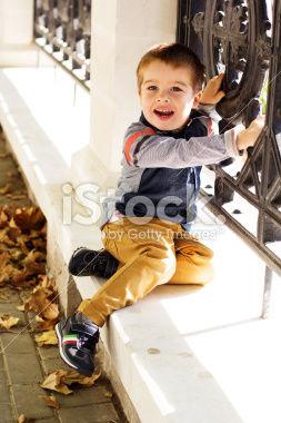 stock-photo-47887650-little-toddler-boy-in-autumn-park