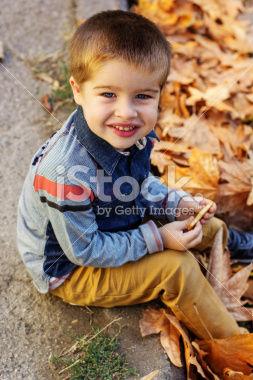 stock-photo-47888274-little-toddler-boy-in-autumn-park