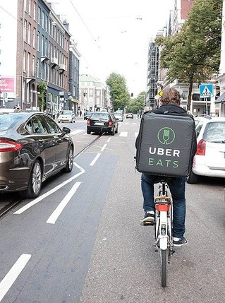 440px-UberEats_cyclist_in_Amsterdam