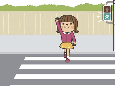 小学生が道路を渡ろうとする