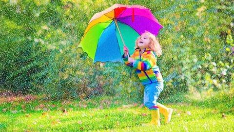 happy-little-girl-rain-umbrella-Dollarphotoclub_70683964