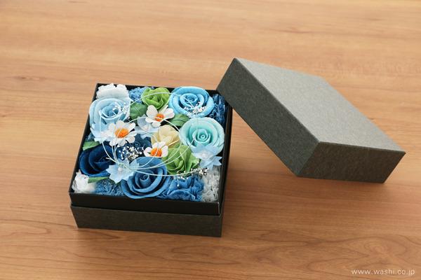 青いバラを主体とした、開業祝いの和紙の花フラワーボックス