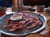 アヒルの肉を焼く