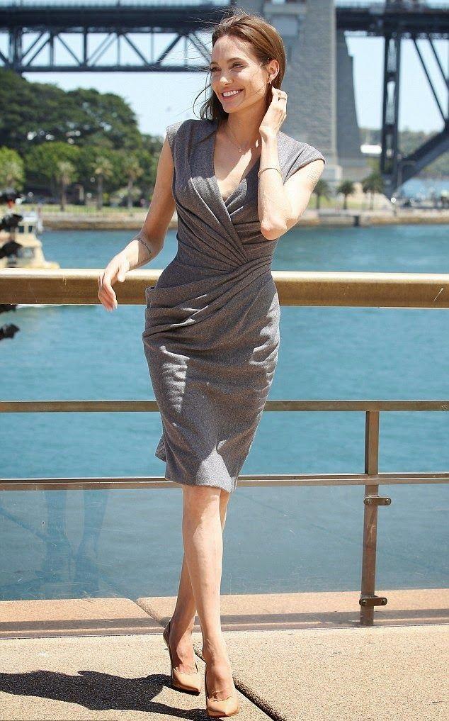 1416278459513_Image_galleryImage_Angelina_Jolie_press_even