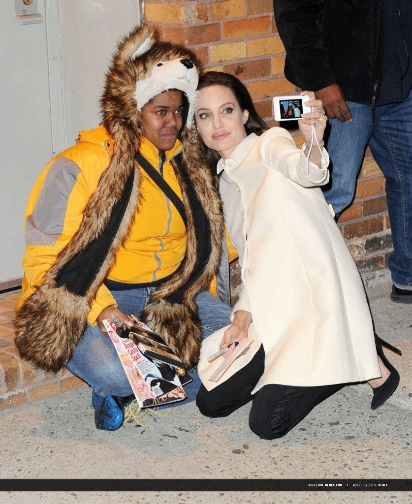 041214_Jolie_Daily_Show_14