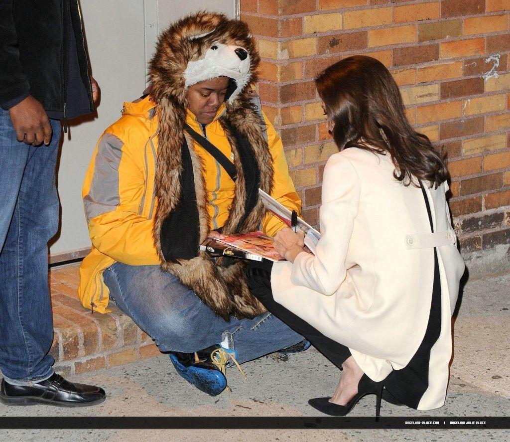 041214_Jolie_Daily_Show_12