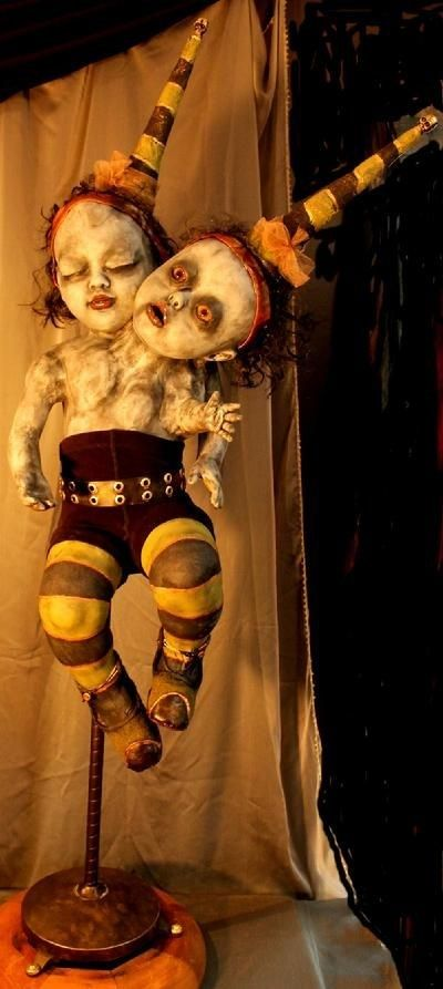 Freaky-Twin-Doll-Toys-with-Its-Victims