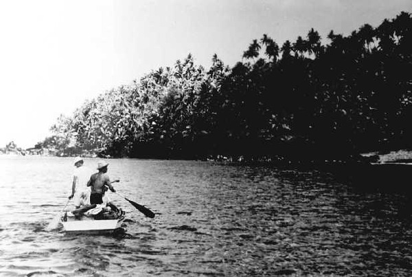 Small_boat_approaches_Anatahan_in_June_1950