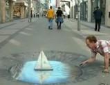 地面に超リアルで立体的な絵を描く男