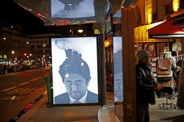 パリに安倍首相の風刺ポスターが貼られまくるに関連した画像-07